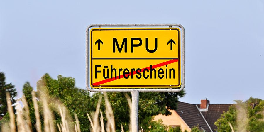 MPU Vorbereitung Wolff - Ortschild in gelb